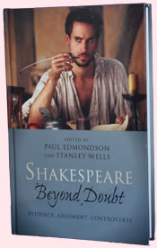 The cover of Shakespeare Beyond Doubt, showing Joseph Fiennes as Shakespeare with a quill pen, a still from the movie Shakespeare in Love.