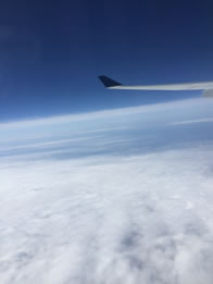 Photo through airline window of clouds