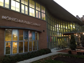 Photo of Montclair Library's entrance at dusk