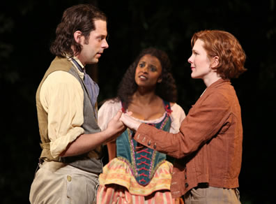 Orlando and Rosalind as Gannymede hold hands, while Celia in shepherdess dress, looks at Orlando