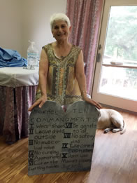 Photo of Maxine Lain holding her tabled of Ten Commandments