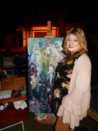 Photo of Lisa Owen with Painting