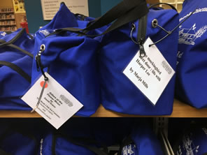 Photo of blue book club kit bags